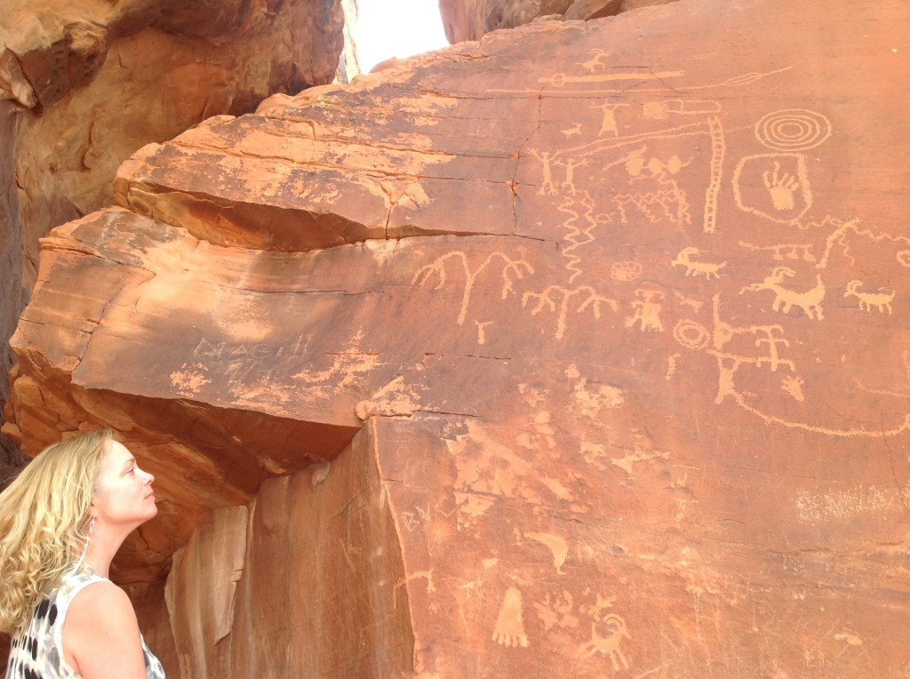 Decorative Artist, Heather Bruno-Sears, admiring prehistoric Indian rock art in the Valley of Fire, Nevada.  Imagining the symbolic meaning of petroglyphs from ancient tripes...