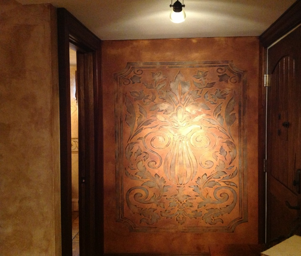 An embossed leather feature wall I tucked into an entrance alcove to complement the 'Old World' design scheme.