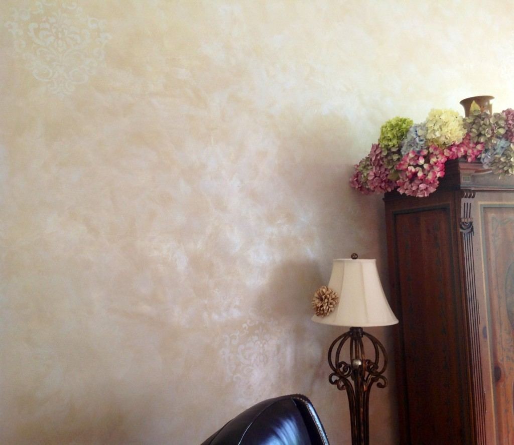 The tone-on-tone hand troweled Lusterstone feature wall was embellished with very subtle damask accents.
