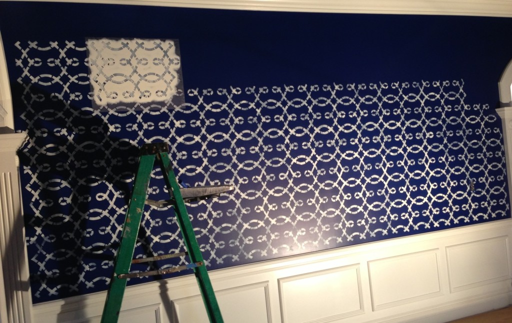 With the family room walls base-coated a rich shade of Sailboat Blue, I began stenciling the basic layout of the ornamental fabric pattern.